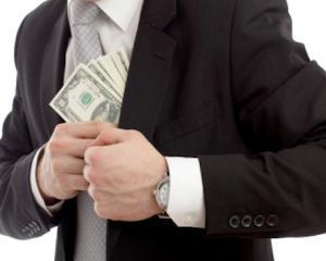 Un angajat al Primariei Sector 2 a fost retinut dupa ce a luat mita 11.000 de euro, pentru acordarea de apartamente ANL